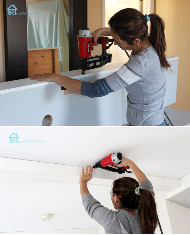 Cristina Garay installing wooden beams in bedroom