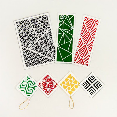 green, red, gold, and black paper cut gift tags, bookmarks, and art piece