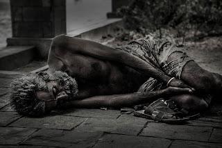 Poor man is sleeping on the Road