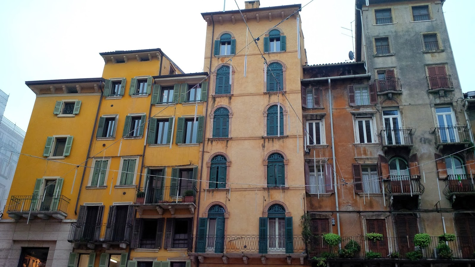 Colourful tall and narrow buildings on Piazza delle Erbe in Verona