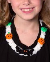 http://www.redheart.com/free-patterns/halloween-motif-necklace