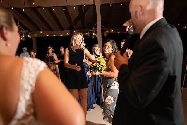 Bouquet toss Magnolia Manor Wedding Photos by Stuart Wedding Photographer Heather Houghton Photography
