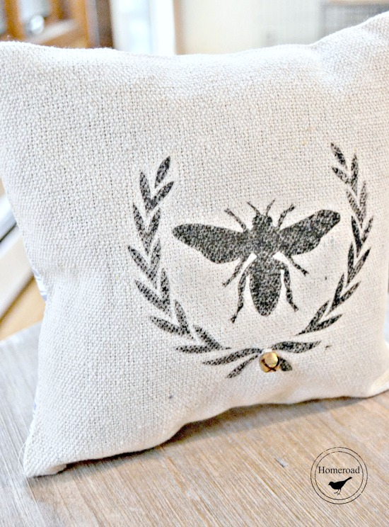 Drop cloth pillows with transferred bee and wreath image