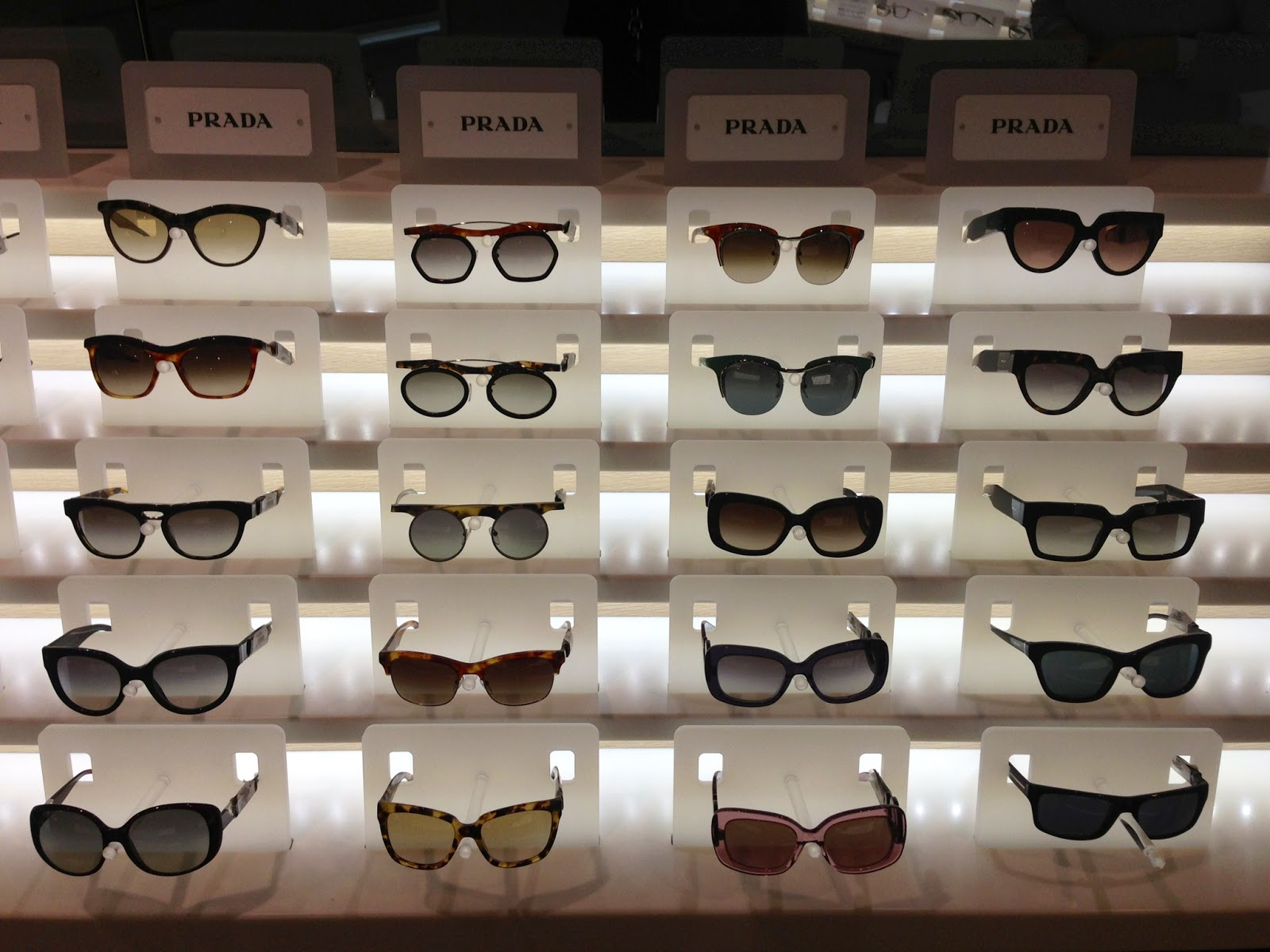 89cd6b568509 Prada Spring Summer Sunglass Collection including the Poeme, Baroque and  Parallel Universe Collections