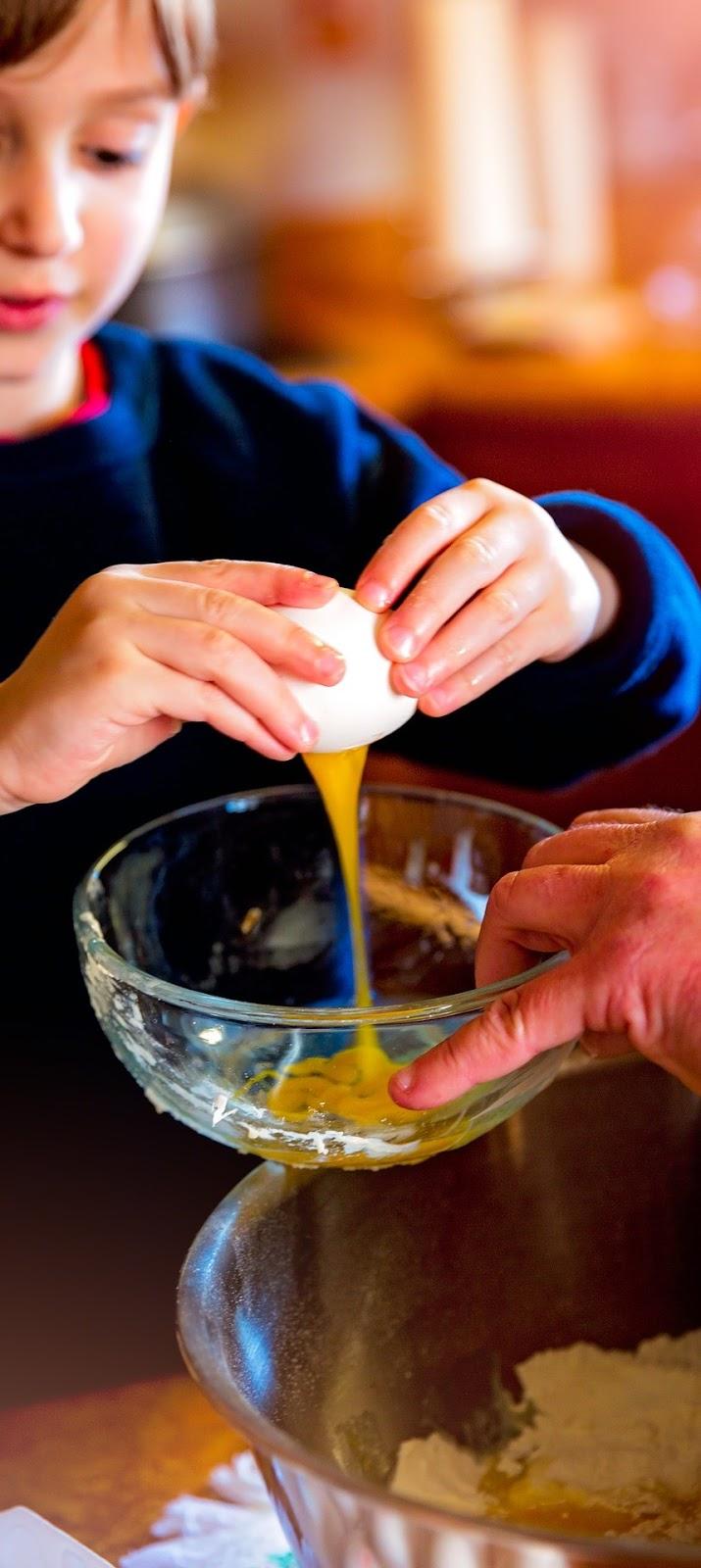 Teaching baking to a child.