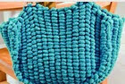 http://www.letsknit.co.uk/free-knitting-patterns/practical_pompon_bag