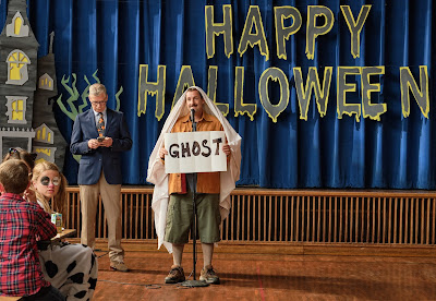 "Adam Sandler dresses up as a ghost in Netflix's original film ""Hubie Halloween."""
