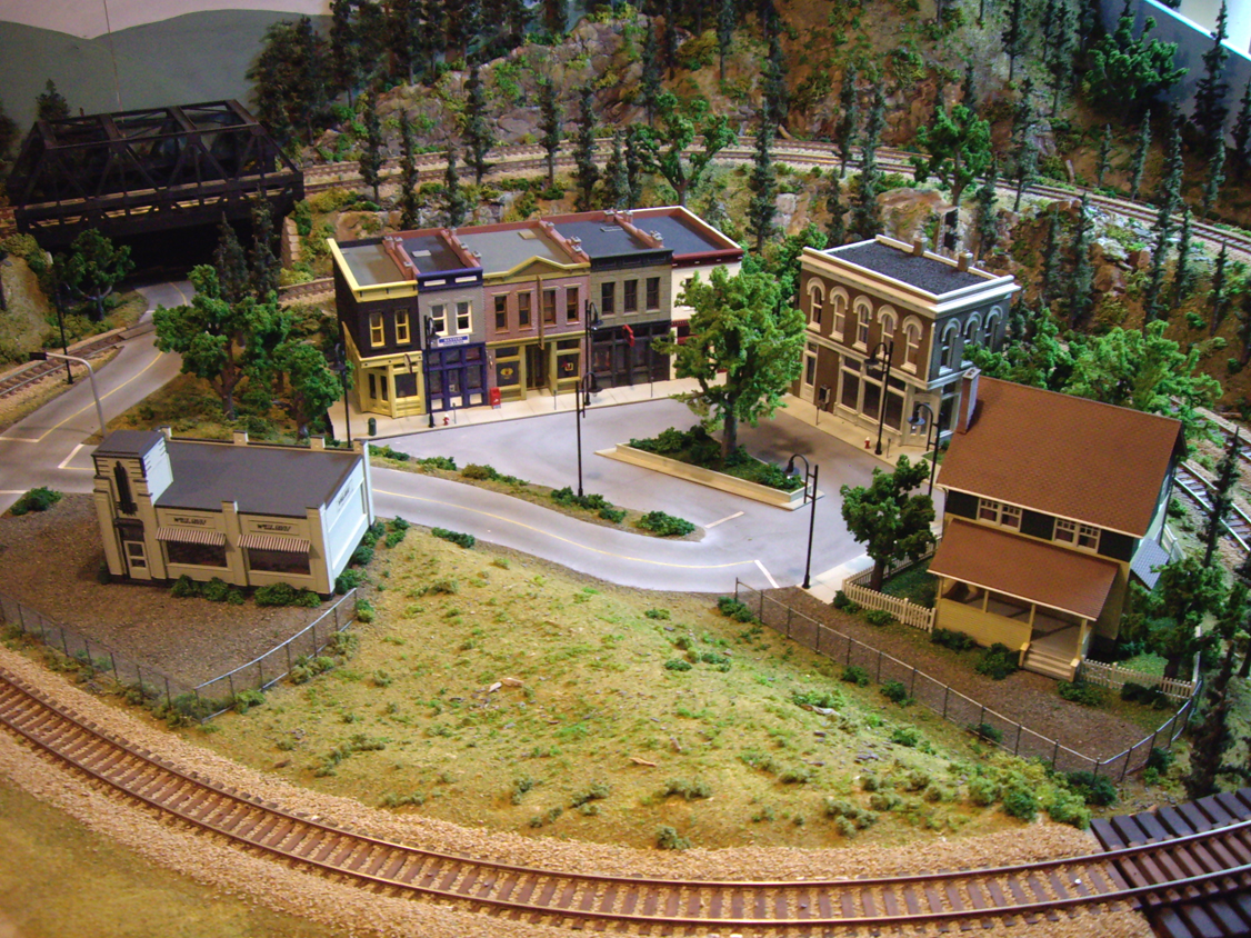 Model railroad town scene with White Castle, Other Corner Café, Merchant's Row 1 and Kate's Colonial Home kit