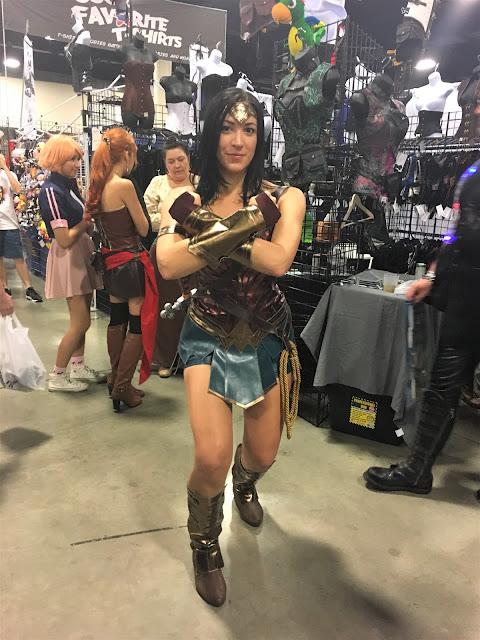 Wonder Woman in her defensive pose.