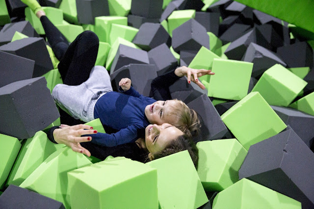 Parent and child enjoying softplay together