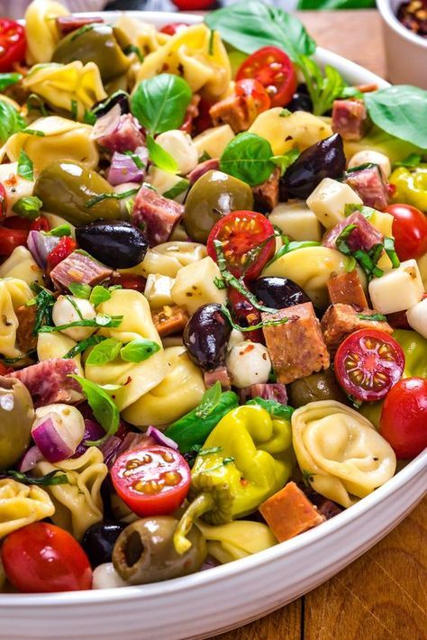 Antipasto Tortellini Pasta Salad. This packed potluck favorite includes multiple cheeses, meats, olives, peppers, and more to create a hearty Italian-inspired summer side dish.