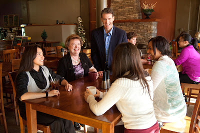 Group of people communicating at a table