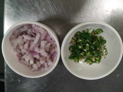 Chopped onion and green chili for aloo paratha recipe