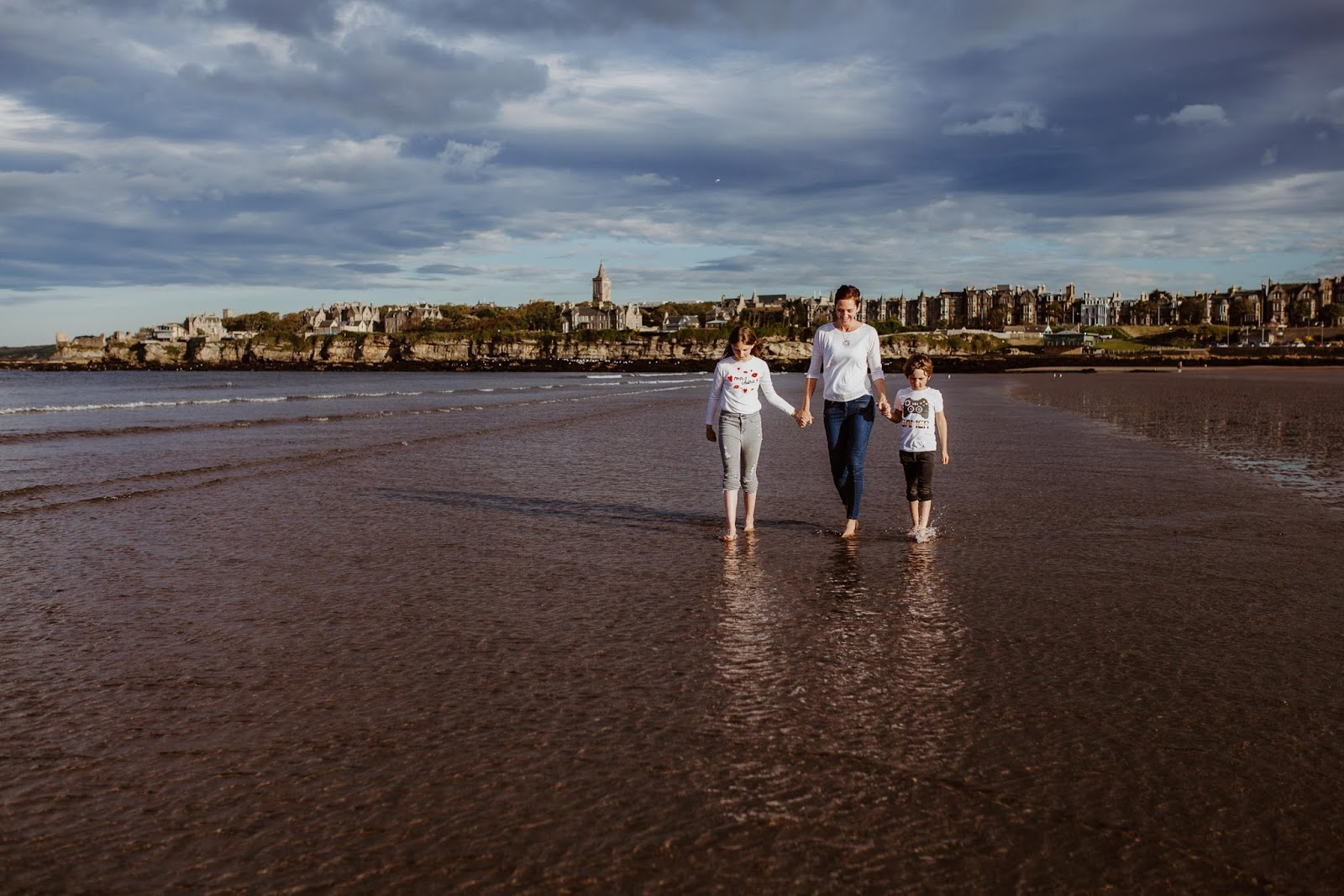 family walking on the beach West Sands St Andrews, candid family photo