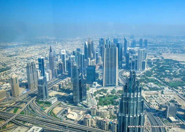 view of Dubai skyscrapers from Atmosphere Burj Khalifa