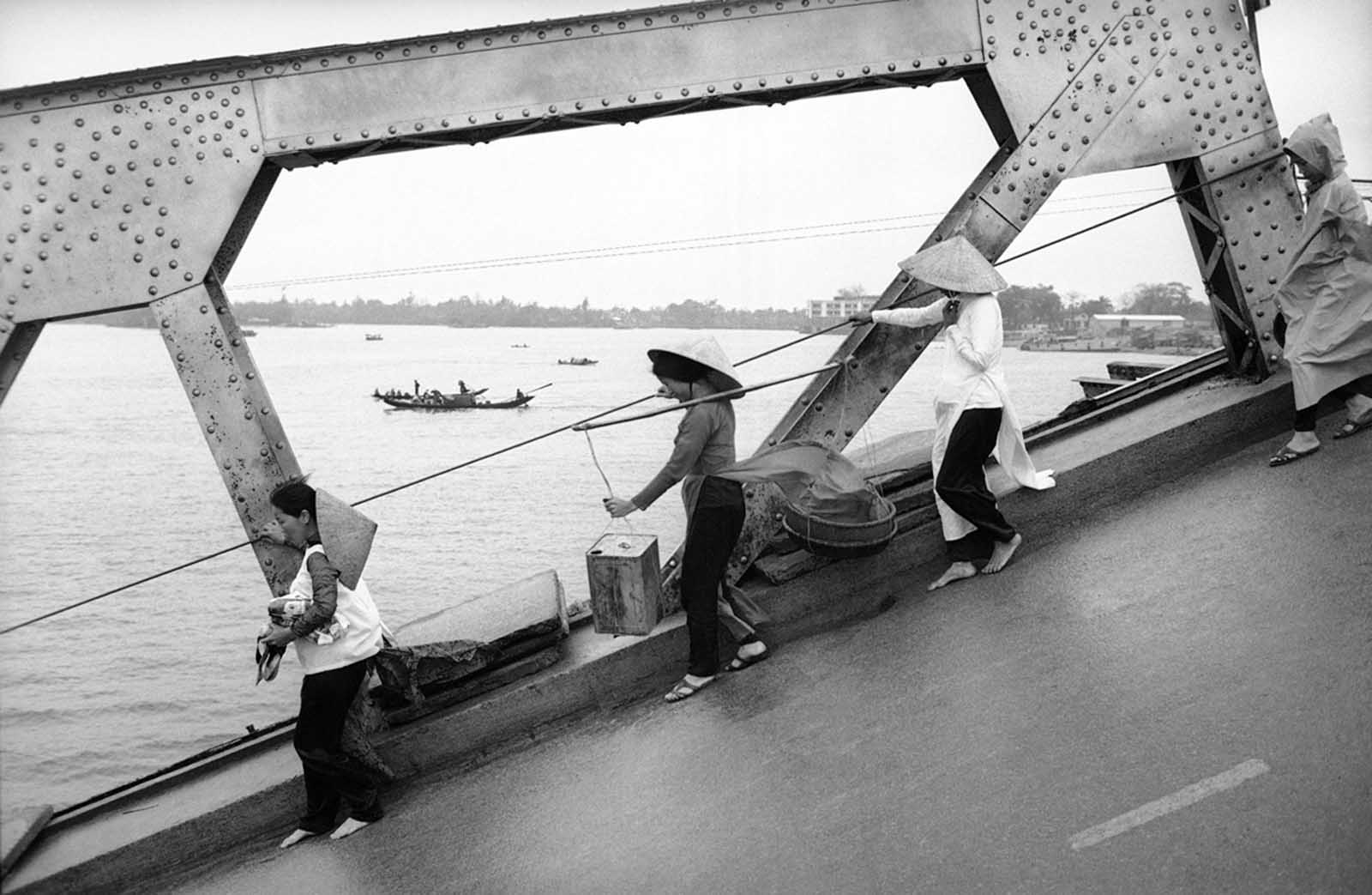 Pedestrians cross the destroyed Hue Bridge in Hue, Vietnam, in an undated photo.