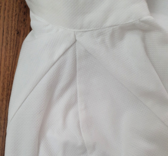 close up of a shoulder seam in a white shirt