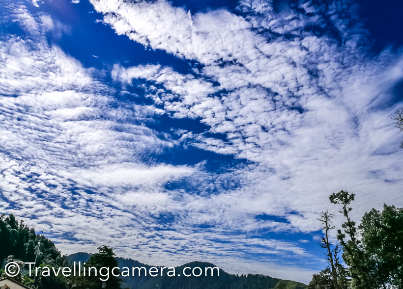 Last month I visited Dalhousie in Himachal Pradesh and loved clicking some of the different moods of clouds and sky. This post just shares sunset and clouds shots from clicked at different times during 4 days of our stay there.Monsoons can be best season to click sunsets, especially just after rains. Either the sky is very clear or clouds are refined and help making shares of light and colors.Above photograph is clicked while we were driving back to Dalhousie from Chamera Dam.Above photograph is clicked from moving car, as you make out by looking at the bottom part of the photograph. You can notice motion blur here.Most of the photographs are clicked from place where we stayed in Dalhousie. After every 5 minutes there was something new & interesting to click in sky. It was hard for me to chose what to post here and what to skip.Colors in sky keep changing, especially during sunset the change if very fast. So you have to be fast in clicking and choosing your favorites. And that's a common phenomenon in hills.Here is a vertical shot of clouds up the sky and river in the bottom of the photograph. Just compare the size of river you see and clouds, & try to imagine the scale.Imagine the height of these clouds and how fast the wind is changing the path for them. A scene just after rains, when sky if bight blue and clouds are dense white to create this perfect contrast.A view of clouds when I woke-up after taking afternoon nap. Photograph is clicked through window net.This photograph is clicked with phone camera and now I realize that I should have created a video of these clouds moving us from dense deodar forest at Khajjiar.