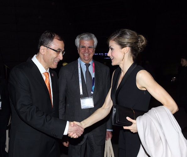 Queen Letizia wears HUGO BOSS Duxida Jumpsuit, Nina Ricci Arc Clutch Prada Toe Pump, Tous Jewelers Earrings