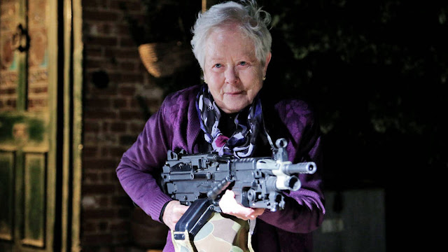 old lady with a machine gun