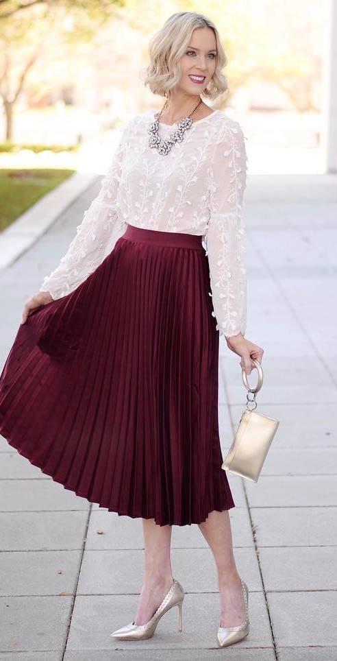a midi maroon skirt that has already mastered the whole flirty peek-a-boo scene
