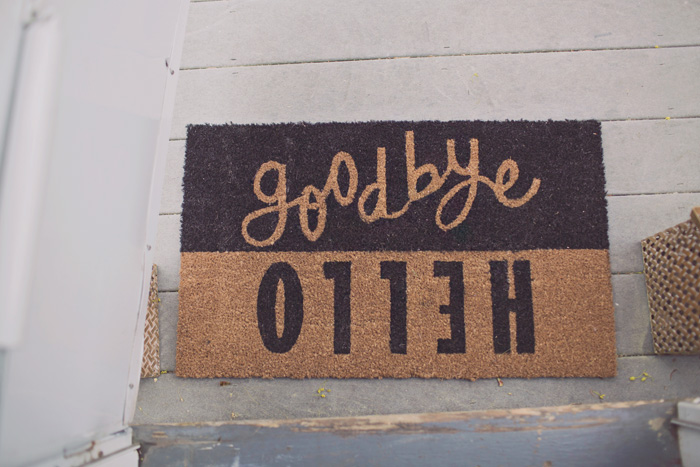 Hello Goodbye front door mat shown exiting home