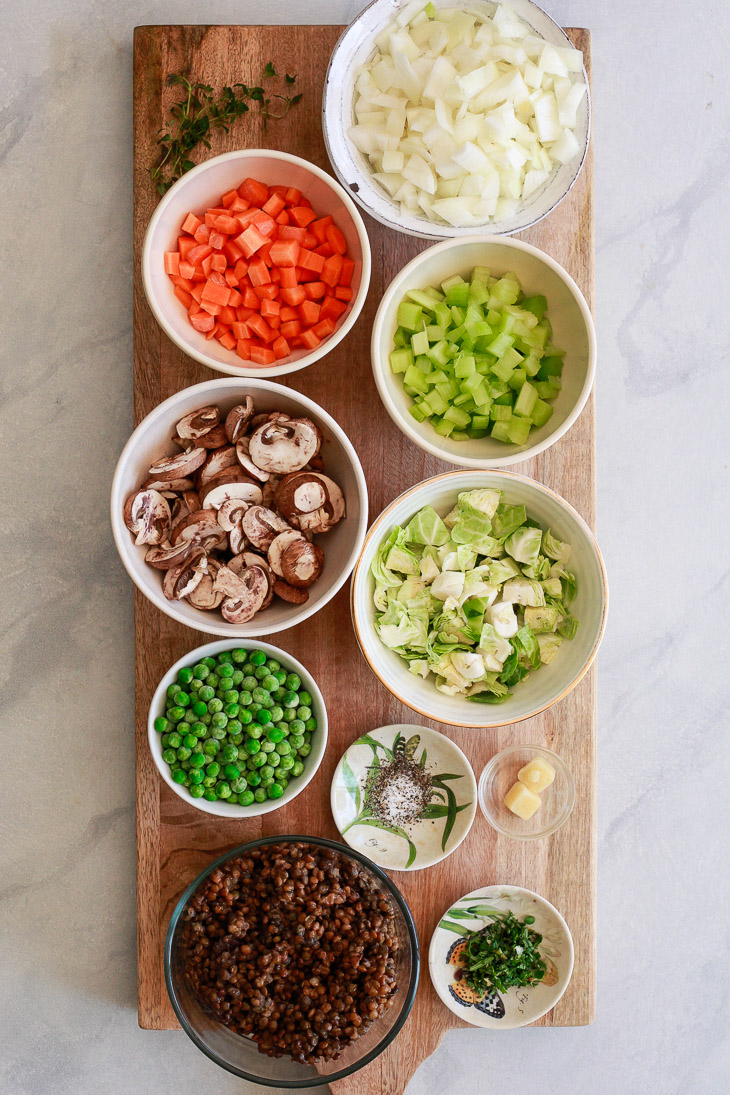 Carrots, celery, mushrooms, peas, and more go into this vegan lentil shepherd's pie recipe.