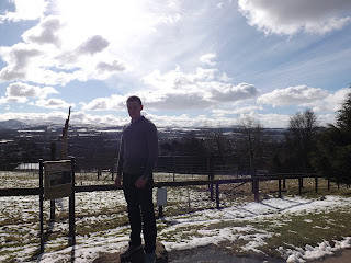 A person standing in front of the view from Edinburgh Zoo