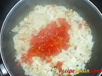 Chopped pepper being fried with the onion