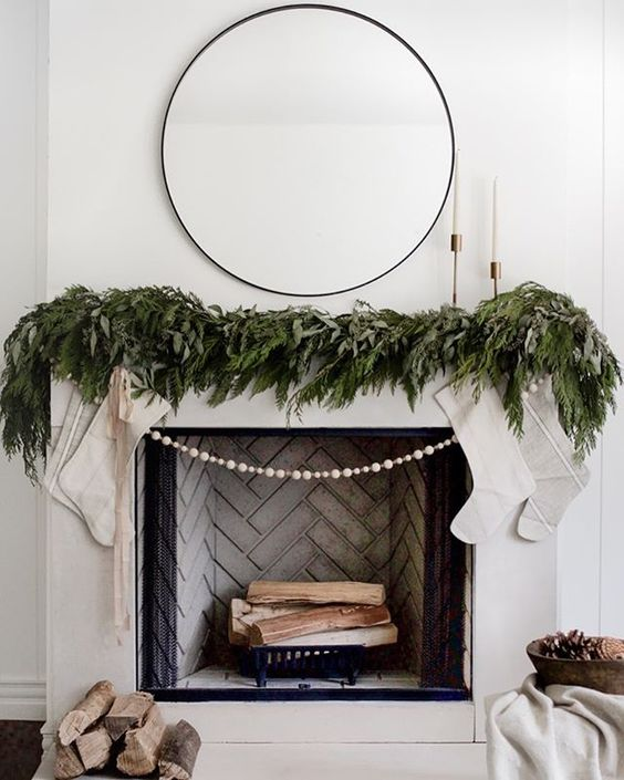 White fireplace with herringbone tile