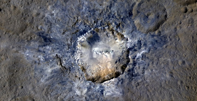 Ceres' Haulani Crater, with a diameter of 21 miles (34 kilometers), shows evidence of landslides from its crater rim. Credits: NASA/JPL-Caltech/UCLA/MPS/DLR/IDA