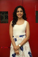 Actress Ritu Varma Stills in White Floral Short Dress at Kesava Movie Success Meet .COM 0053.JPG