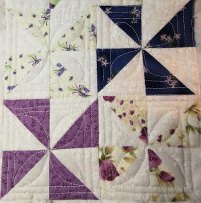 Pinwheel block with borders and inside petals