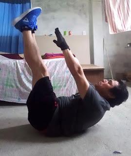 Crunch abdominal con las piernas en ángulo recto