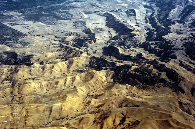 Shot from a plane, this photo shows mountain rangers, valleys and small towns.
