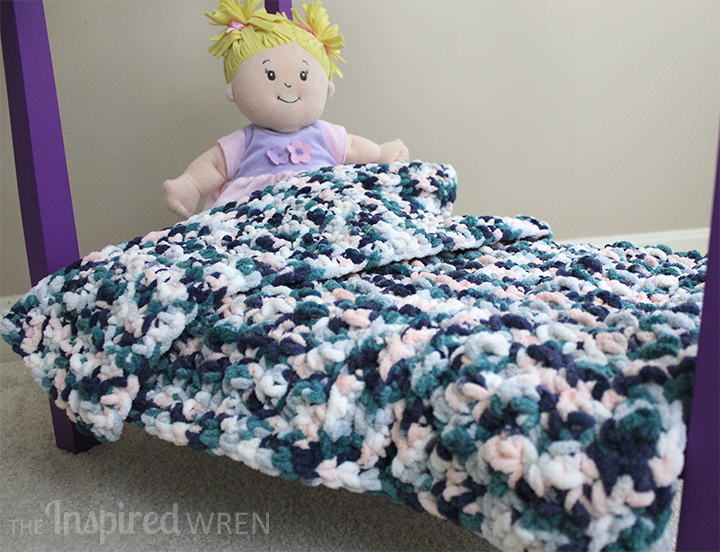 Chunky Doll Blanket: Quickly hook up a squishy doll blanket with this simple, contemporary crochet pattern worked in super bulky yarn. | The Inspired Wren