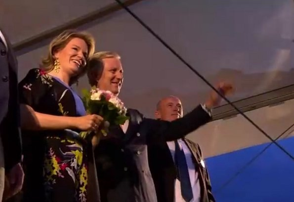 Queen Mathilde wore Diane von Furstenberg Floral-printed silk jumpsuit. Princess Astrid and Prince Lorenz at National Day and Bal National festivities