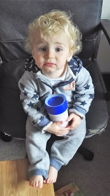 Poorly toddler with a litecup