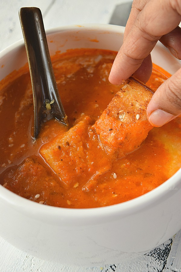 a bowl with easy homemade tomato soup with homemade croutons