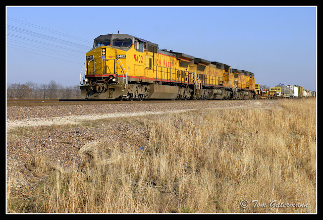 UP 9402 leads a train north at Flinton Station Road, at Modoc, IL.