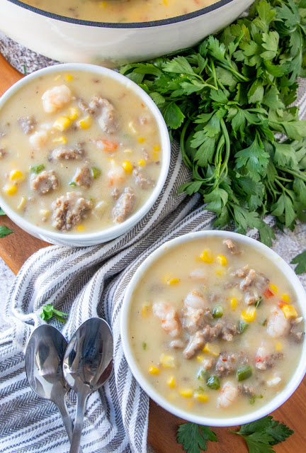 Two bowls of chowder with two spoons