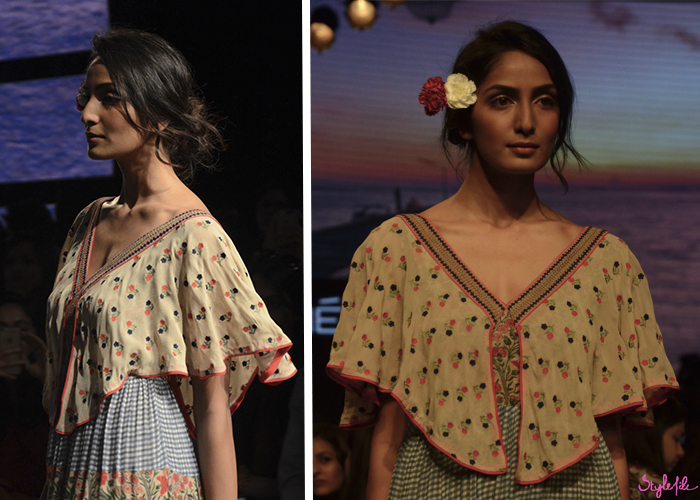A model wears a messy bun with loose curls and flowers in her hair for Verb at Lakme Fashion Week Summer Resort 2016 at St. Regis, Mumbai