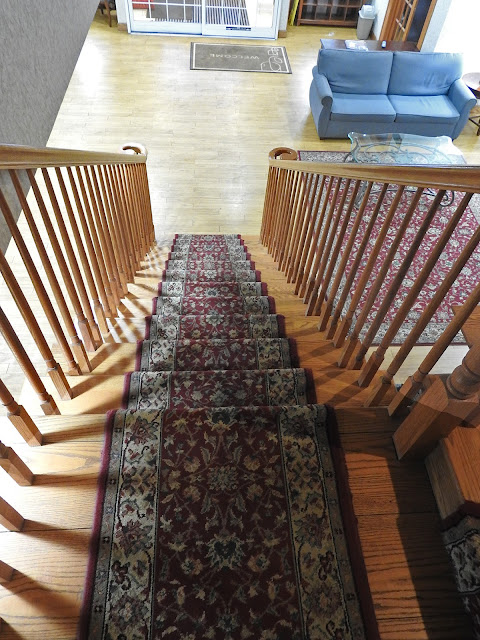 Looking down an oak staircase.
