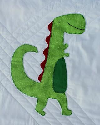 Green dinosaur applique baby quilt block