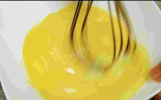 Whisking eggs for egg bhurji recipe