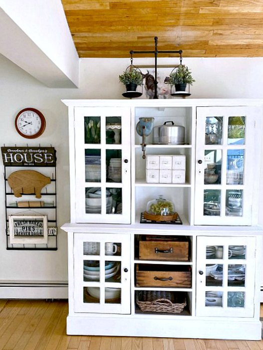 Kitchen view with large white hutch