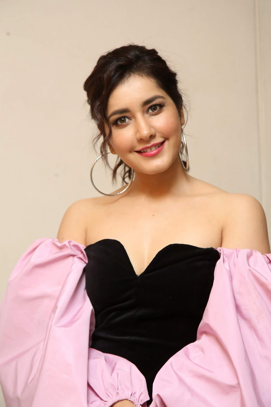 Raashi Khanna in a beautiful Sleeveless Black Deep neck Gown