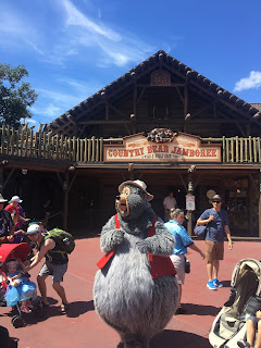 Big Al in front of the Country Bear Jamboree Magic Kingdom Disney World