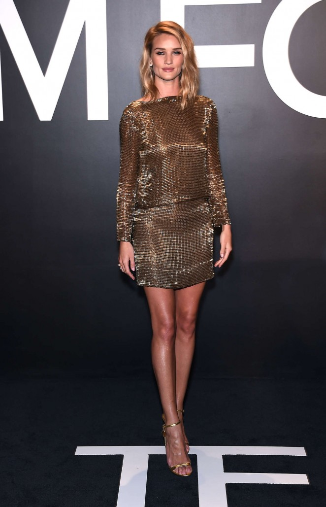 Rosie Huntington-Whiteley in a backless gold mini dress at the Tom Ford Fall/Winter 2015 Fashion Show in LA