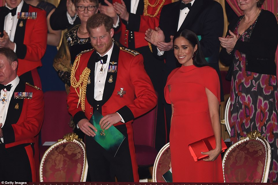 Harry and Meghan get a standing ovation as he wears his dress uniform